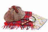 Deerhunter cap, magnifying glass, tartan scarves and London map — Stock Photo
