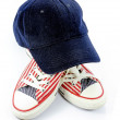 Cap and pair of shoes with american stars and stripes decoration — Stock Photo