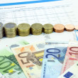 Coins and euro banknotes composition — Stockfoto