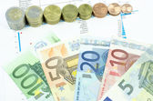 Economy concept euro banknotes and coins — Stock Photo