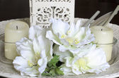 White flowers and candles off — Stock Photo