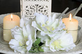 White flowers and candles on — Stock Photo