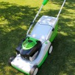 Lawn mower on the lawn — Stok fotoğraf