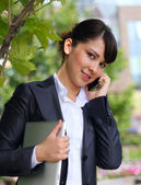 Business lady with phone — Stock Photo