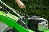 Checking the oil in a lawn mower. — Stock Photo