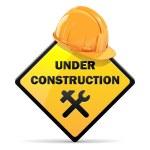 Vector Under Construction Sign with Helmet — Stock Vector