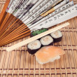 Sushi and a fan with Japanese characters — Stock Photo #29373961