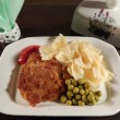 Stock Photo: Steak and pasta with ketchup, green peas