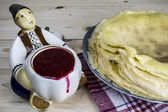Pancakes and raspberry jam, statuette — Stock Photo