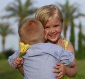 Boy embraces a girl — Stock Photo