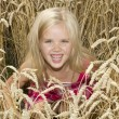 Girl in wheat — Stock Photo
