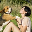 Girl with a dog in the park — Stock Photo