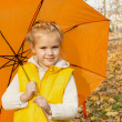 Beautiful girl hiding under an umbrella — Stock Photo
