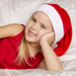Beautiful little girl in santa cap — Stock Photo