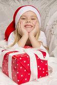 Girl opening Christmas gift — Stock Photo