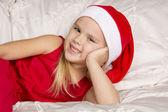 Beautiful little girl in santa cap — Stock Photo