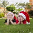 Beautiful boy and girl in santa hats — Stock Photo #37312347