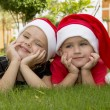 Beautiful boy and girl in santa hats — Stock Photo #37312353