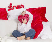 Lover boy hides his face behind heart — Stock Photo