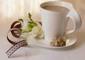 Cup of cappuccino and a sweet — Stock Photo