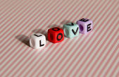 Word love is built of colored cubes — Stockfoto