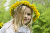 Girl in a wreath of flowers — Stock Photo