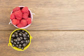 Raspberry and blueberries spread on the table — Stock Photo