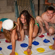 Twister game players bizarre postures — Stock Photo #29532381