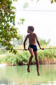 People walk on a tightrope Slackline — Stock Photo