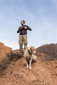 A man walks by Gore with labrador dog — Stok fotoğraf
