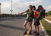 Two Lovers Hitchhiking, stand with a blank sign — Stock Photo