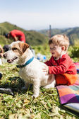Small child playing with a dog on the nature — Stock Photo