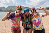 Bright teenagers having fun on the beach — Stock Photo