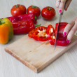 Closeup of hands chopping vegetables in the kitchen — Stock Photo