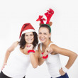 Two Santa Girls making gifts for Christmas holiday — Stock Photo #32472977