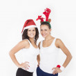 Two Santa Girls making gifts for Christmas holiday — Stock Photo