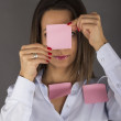 Business woman with sticky notes on her face — Stock Photo