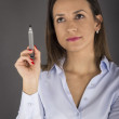 Young businesswoman writing with pen — Stock Photo