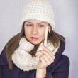 Stock Photo: Young woman having flue taking thermometer.