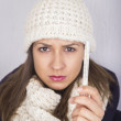 Young woman having flue taking thermometer. — Stock Photo