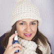 Young woman using throat spray. — Foto de Stock