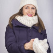Smiling winter girl woman putting on gloves — Stock Photo