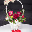 Beautiful red roses in a basket — Stok fotoğraf