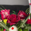 Beautiful red roses in a basket — Stockfoto