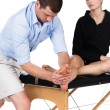 Physiotherapist massaging patient — ストック写真