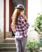 Girl in hat posing outdoors — Stock Photo