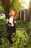 Asian girl posing in green park — Stock Photo