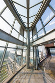 Interior inside of glass building — Stock Photo