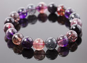 Colorful bracelet made of glass stones — Stock Photo