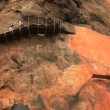 Stock Video: Scaffolds for walking fixed on steep rocks in Sigiriya.
